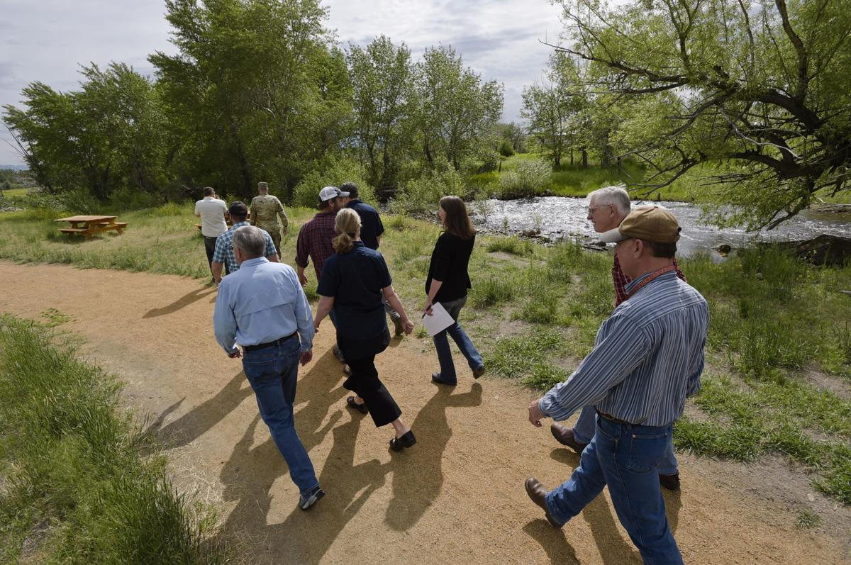 Officials from Prickly Pear Land Trust lead a tour of the new Ten Mile Creek Park