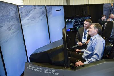 Sen. Steve Daines operates an F-35 Lightning II simulator