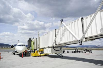 A Delta Airlines planes sits parked at the new jet bridge