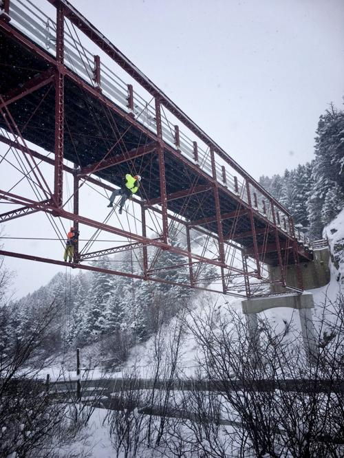 Climbing inspectors complete a full inspection of the Dearborn River High Bridge on Dec. 20 in preparation for rail and deck repairs this week.