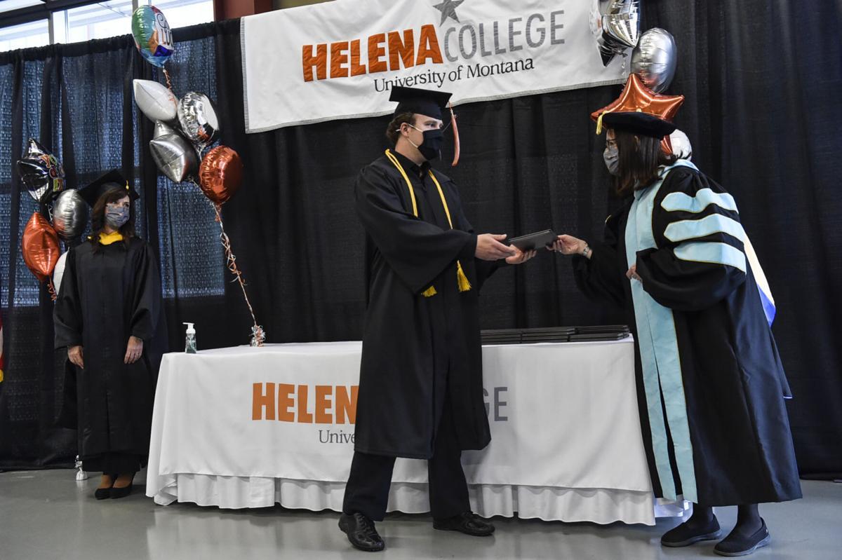 Ben Barnard receive his diploma from Helena College Dean Dr. Sandra Bauman