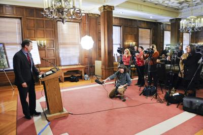 Members of the Montana press corps cover a press conference