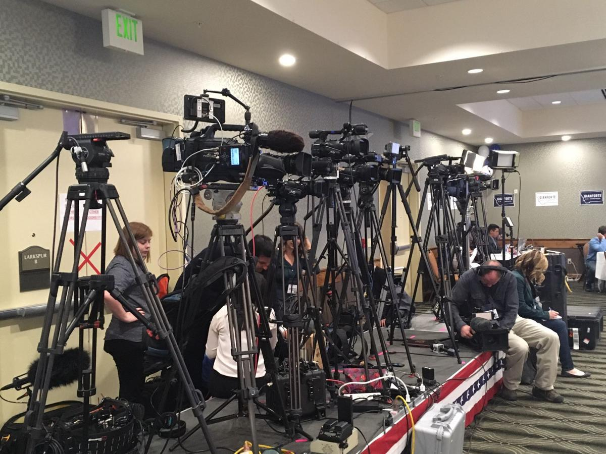 Network cameras line a riser at the Gianforte poll watching party.