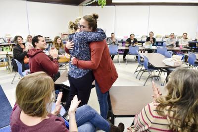 Rylee Holman, right, hugs her former teacher Anna Thennis