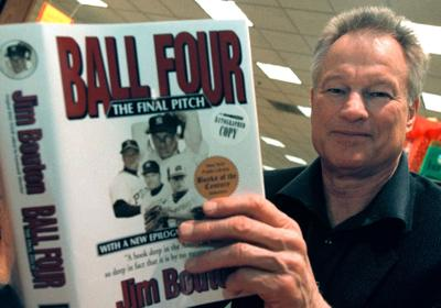 "Former major league pitcher Jim Bouton signs copies of his book, ""Ball Four: The Final Pitch,"" on November 27, 2000, in Schaumburg, Ill. (Tim Boyle/Newsmakers) **FOR USE WITH THIS STORY ONLY**"