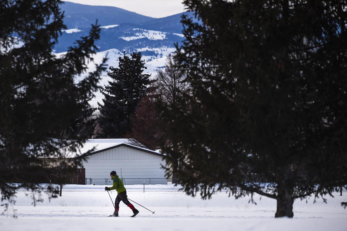 A cross country skier skis at Bill Roberts Golf Course