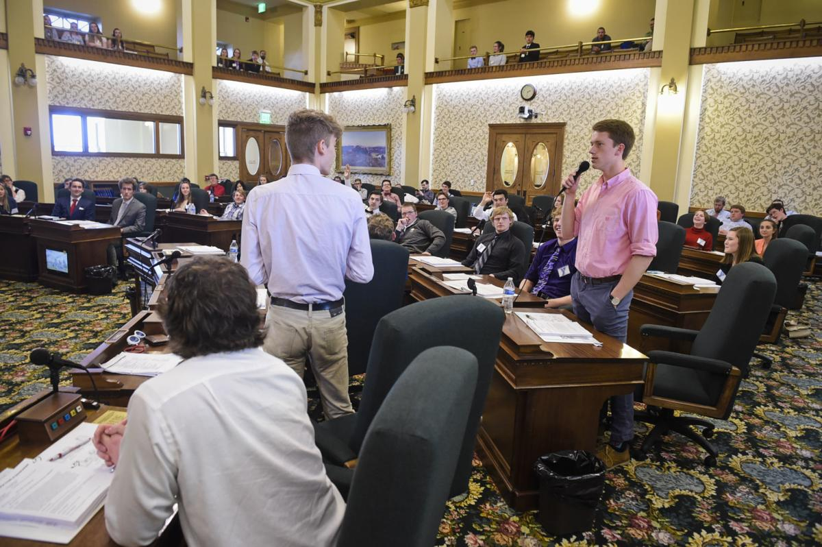 Student lawmakers debate the merits of a bill on the floor of the Montana Senate Monday at the State Capitol.