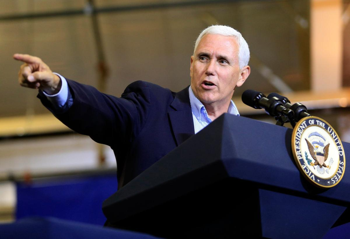 Vice President Pence points to the crowd