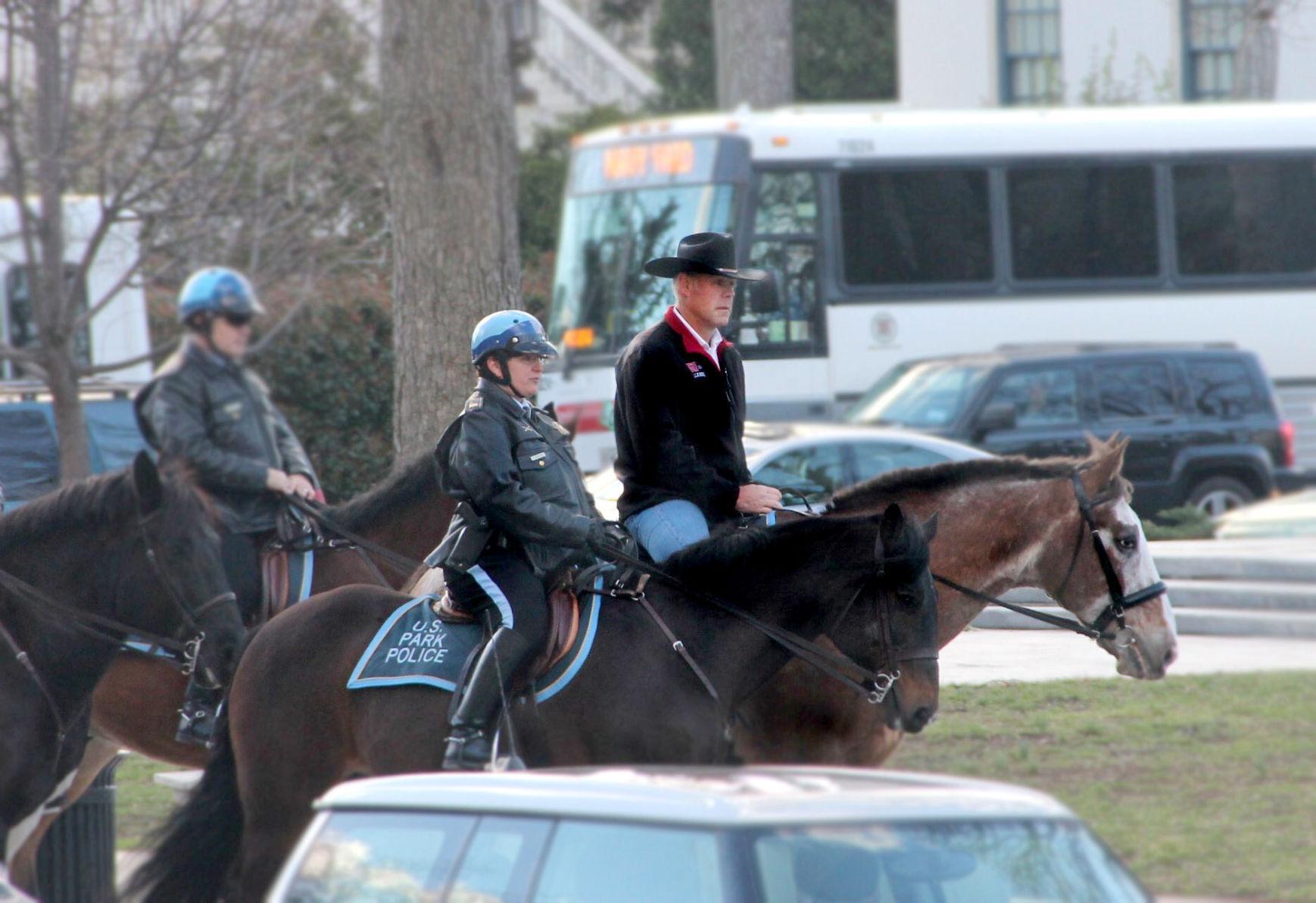 Zinke riding horse