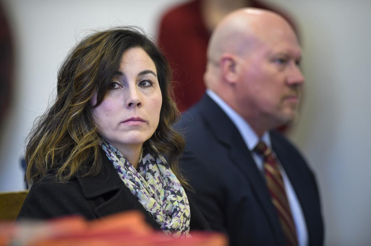 Former Capital High School Rene Carter, left, appears with her lawyer,