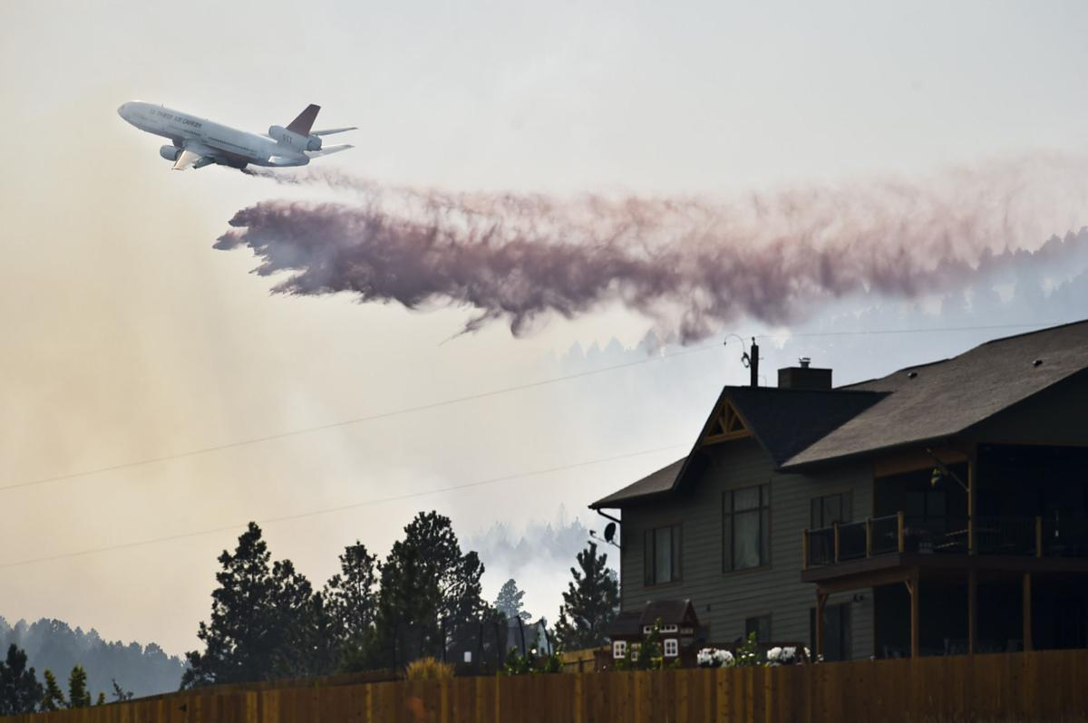 A VLAT, or very large air tanker, drops a load of retardant on a lightening sparked fire south of Helena Thursday evening.