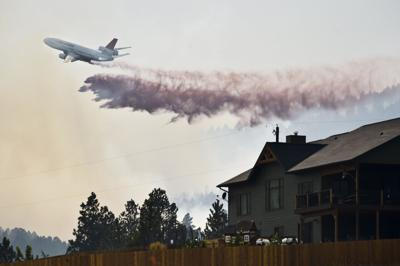 A Vlat Or Very Large Air Tanker Drops A Load Of Retardant On A