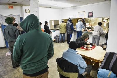 Dinner is served to a larger than usual crowd at God's Love shelter