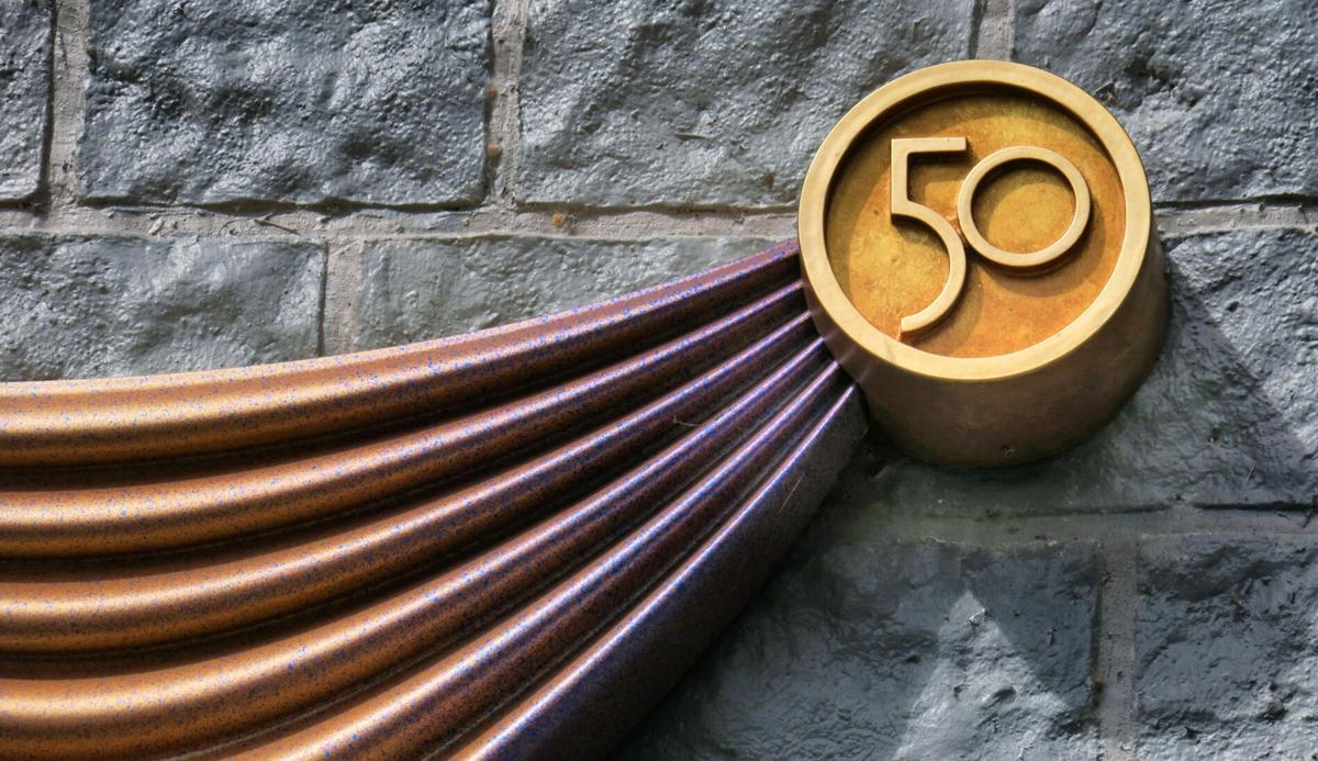 "A ""50"" logo is built into the pin portion of the decorations being added to Cinderella Castle."