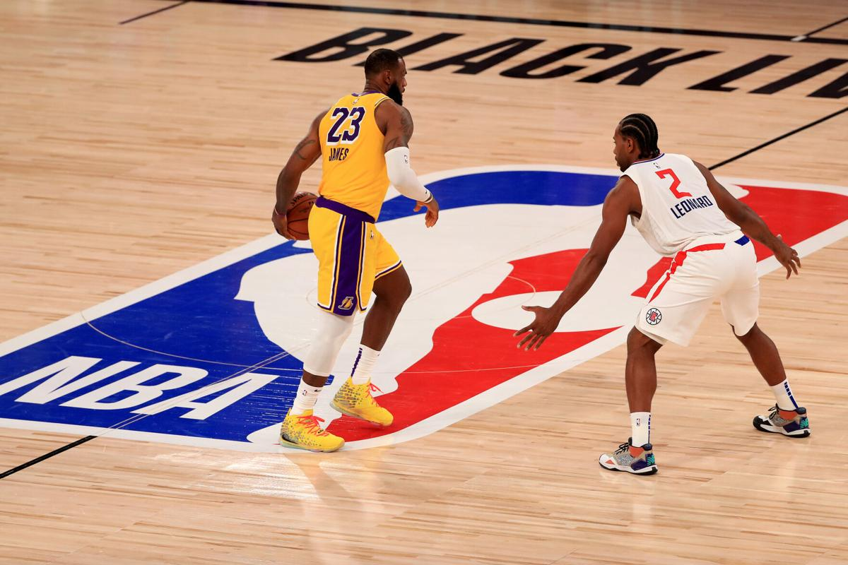 LAKE BUENA VISTA, FLORIDA - JULY 30: LeBron James #23 of the Los Angeles Lakers dribbles the ball against Kawhi Leonard #2 of the LA Clippers during the third quarter of the game at The Arena at ESPN Wide World Of Sports Complex on July 30, 2020 in Lake Buena Vista, Florida.