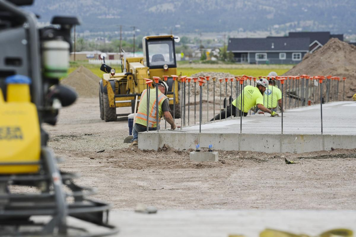 Concrete workers finish the foundation for the new Valley Ace Hardware store adjacent to Bob's Valley Market Friday.