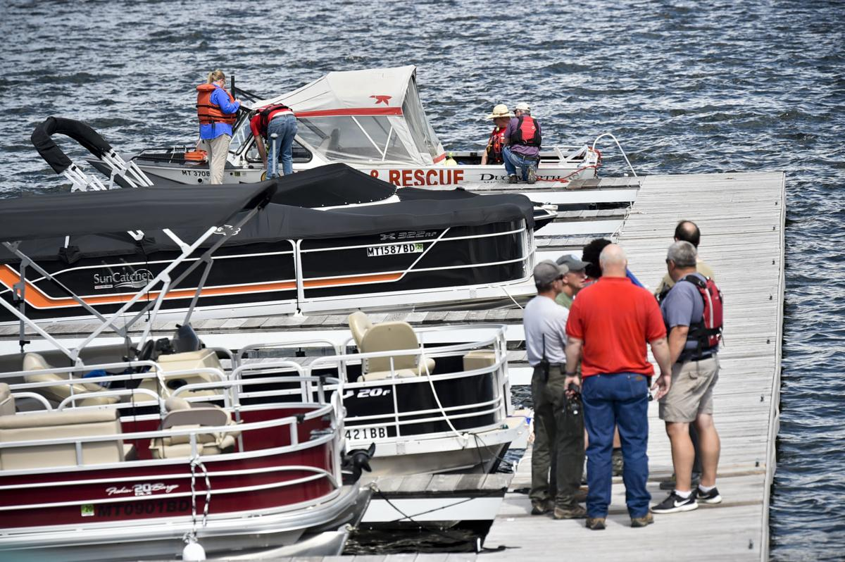 Emergency responders stage at the Yacht Basin Marina