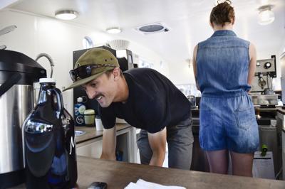 Rachael Weidlich and Steven Ladefoged make espresso drinks