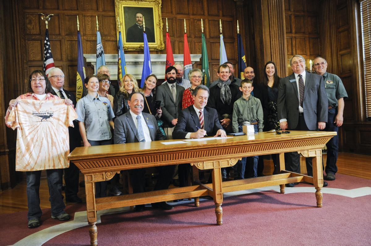 Gov. Steve Bullock signs into law