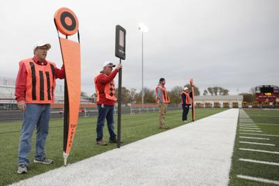 Meet the eagle-eyed 'chain gang' members who keep Central Illinois football games measured and moving