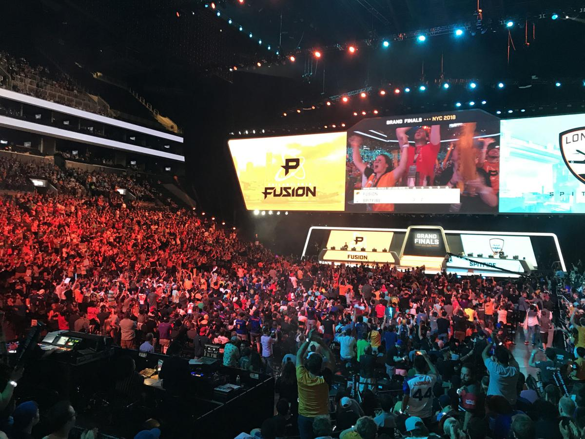 Fans of the e-sports Overwatch League watch as the sixth-seeded Philadelphia Fusion compete against the fifth-seeded London Spitfire in the Overwatch League Grand Finals at the Barclays Center in New York City, N.Y. on Saturday, July 28, 2018.