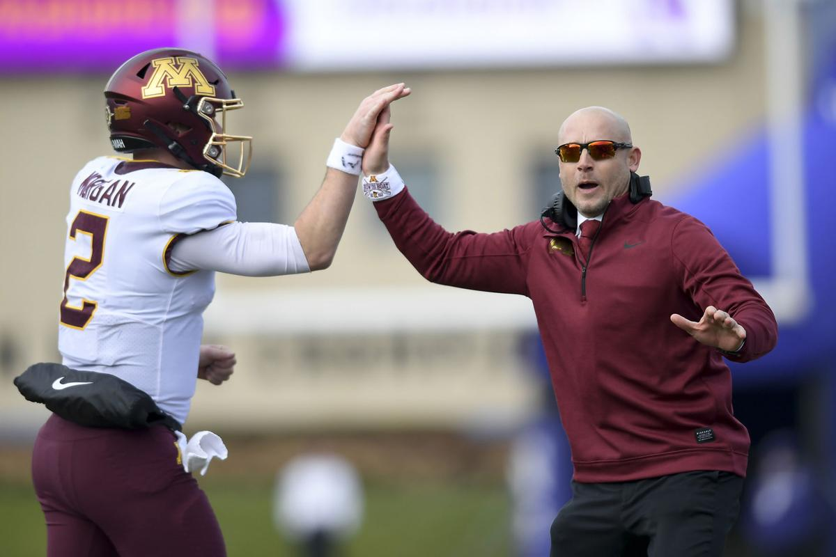Minnesota Gophers quarterback Tanner Morgan (2) high-fives head coach P.J. Fleck after Morgan's fourth quarter touchdown pass to wide receiver Tyler Johnson (6) on Saturday, Nov. 23, 2019 at Ryan Field in Evanston, Ill.