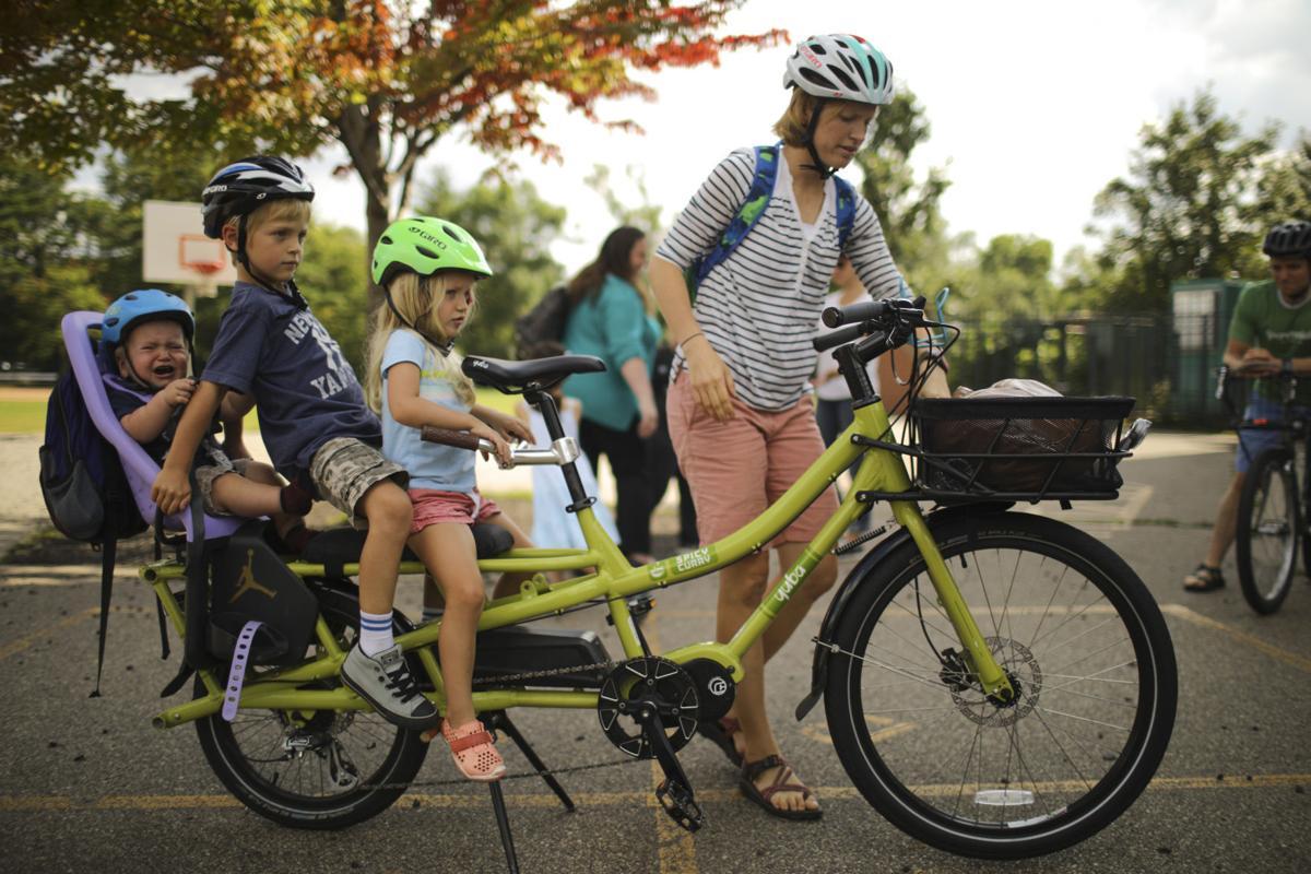 Who needs a minivan? Parents cart kids on cargo bikes