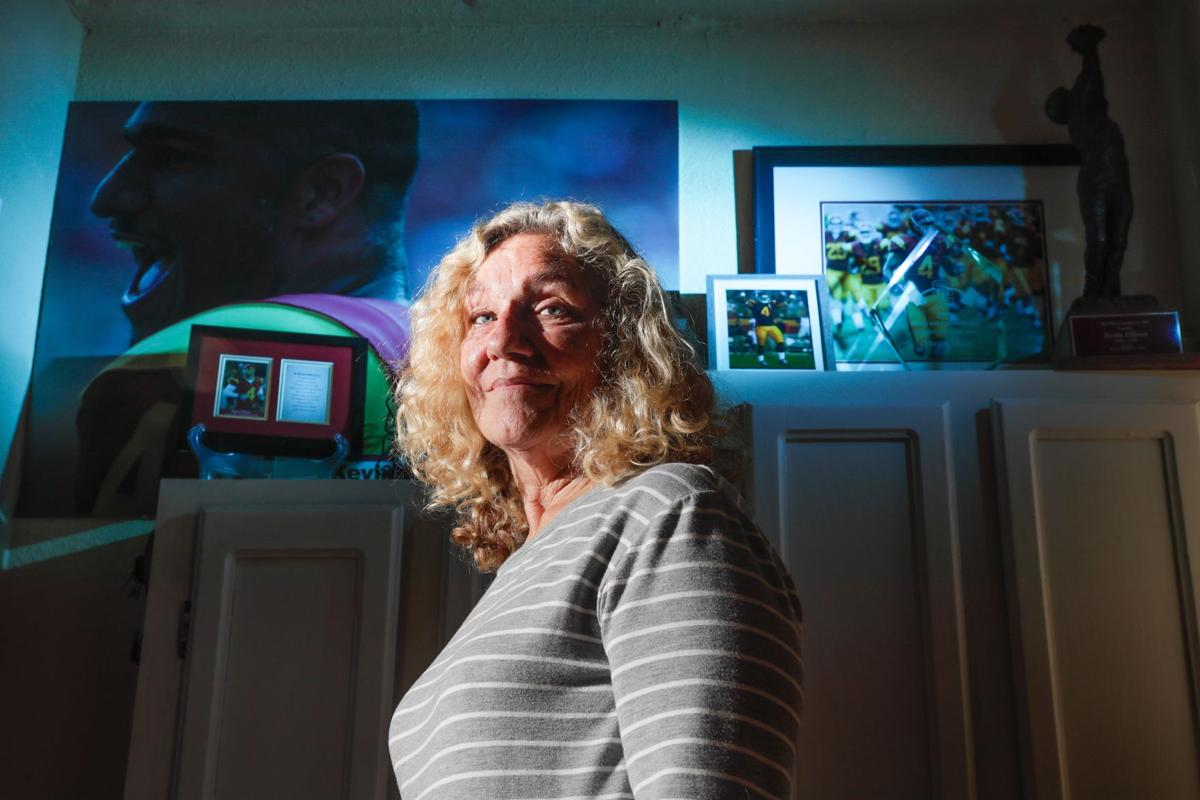 Judy Reisner at home with photos of son Kevin Ellison a few days before the one-year anniversary of his death.