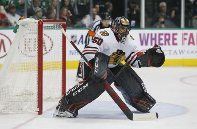 Chicago Blackhawks goalie Corey Crawford (50) was one of 57 players invited  to training camp. c36ff3191