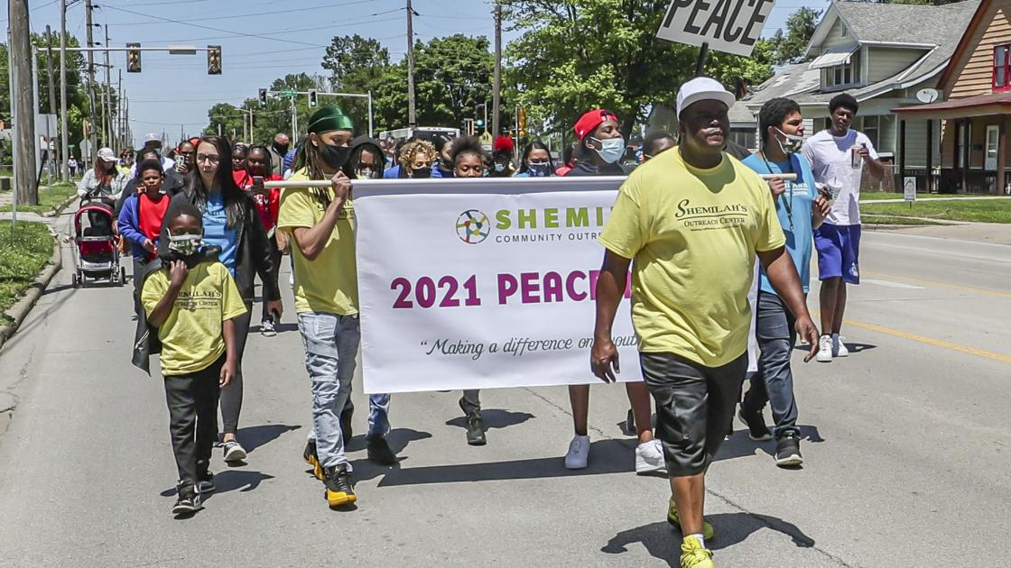 Watch now: Decatur residents march for peace, say 'enough is enough'