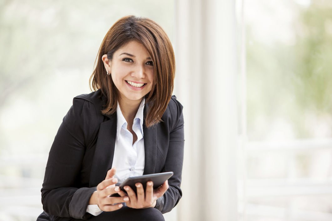 Happy businesswoman with a tablet