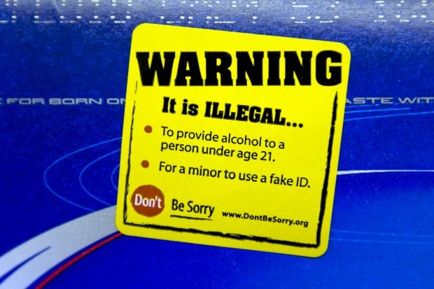 Students slap stickers on booze to remind shoppers of underage