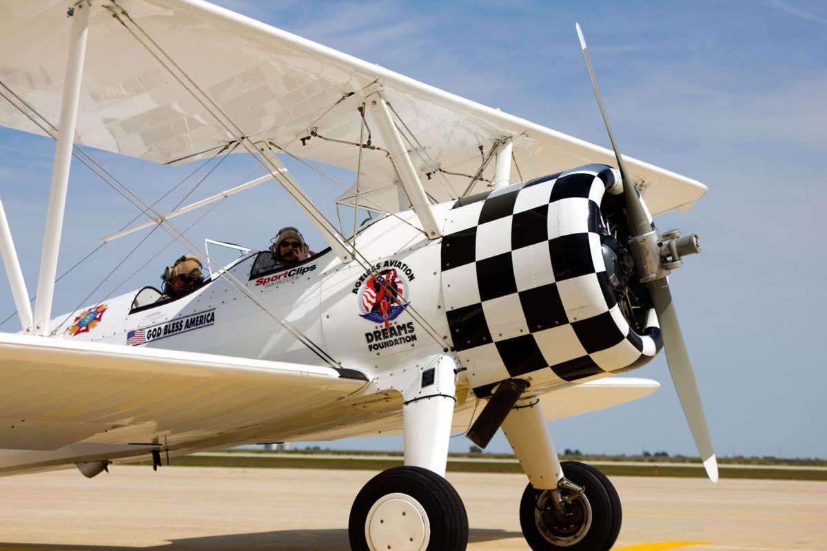 St. Patrick's Isabella Ledesma Takes off in Biplane