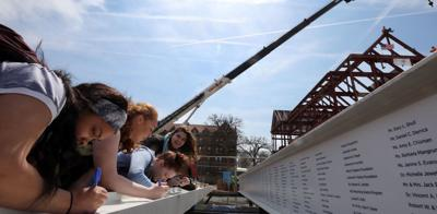 """""""This is your building!"""" Signed beams placed at top of Millikin Center for Theatre and Dance honor donors"""