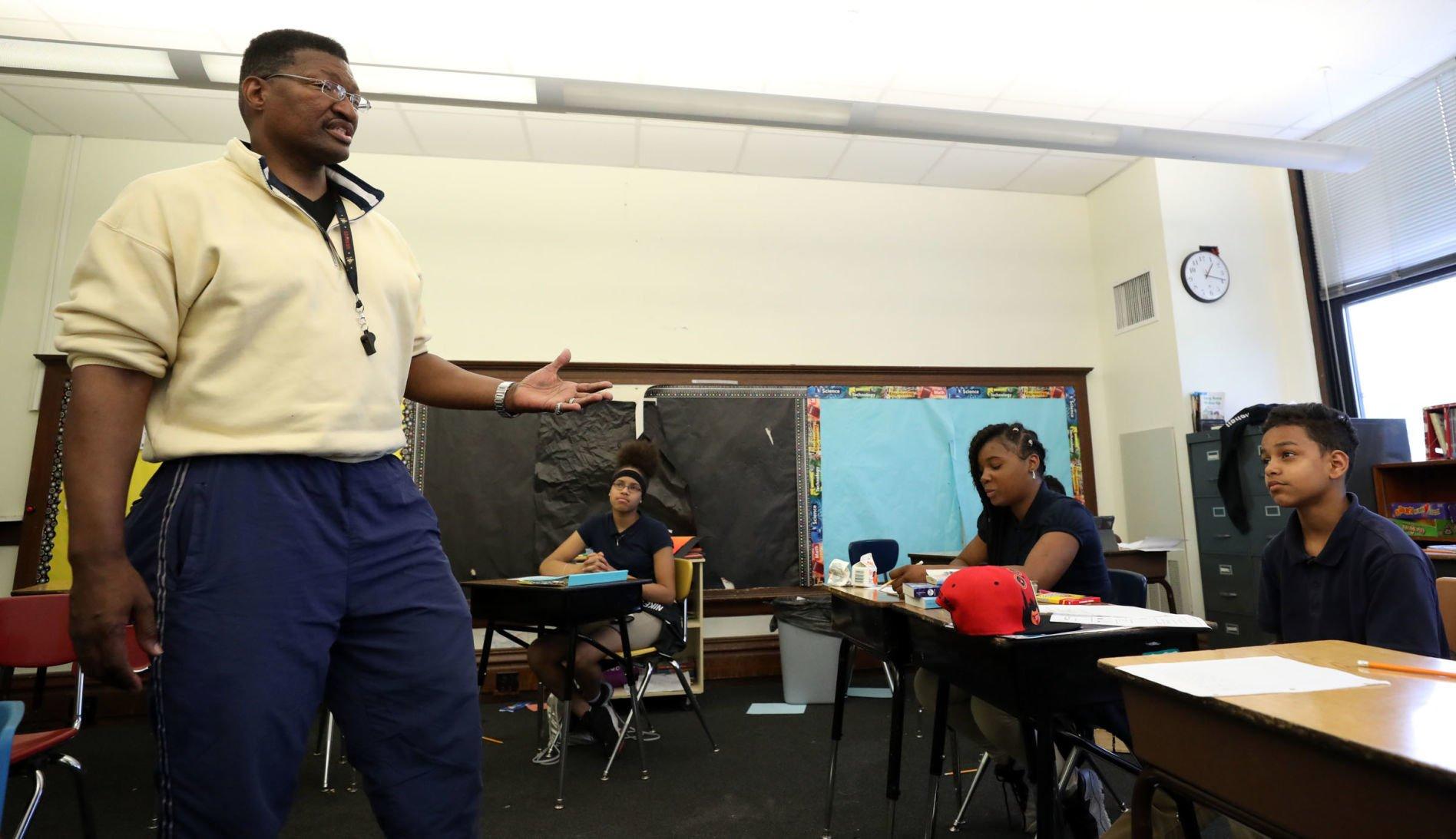 school district runs background check on teacher racism