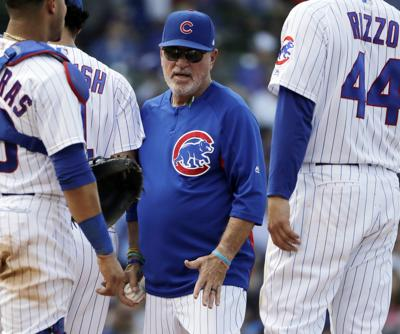 chicago cubs manager joe maddon center pulls starting pitcher yu darvish from a may game against the colorado rockies maddon says bryce harper not