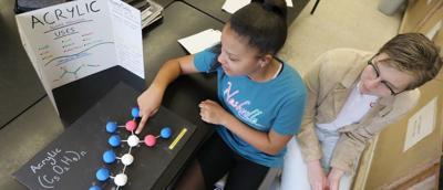 Molecule models, new lab stools enliven Johns Hill Magnet School science class