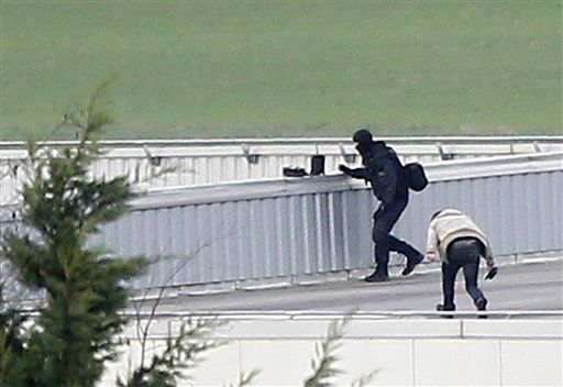 French police kill gunmen in twin attacks, free 16 hostages