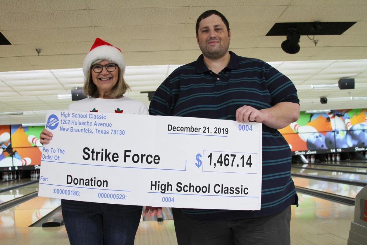 Cory West, Tournament Organizer, presents grant award to Marilyn Senneway, Strike Force.jpg