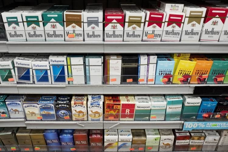 Cigarettes on shelf - AP file