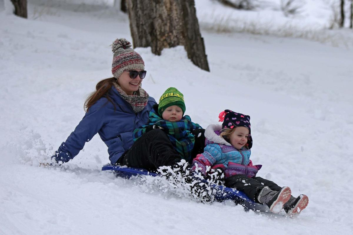 Locals enjoy snow day at Moore Park