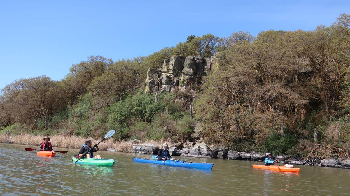 Kayak, rock outcrop