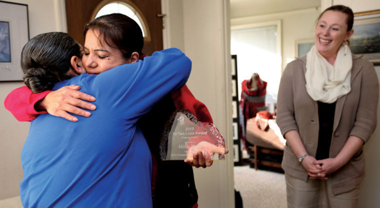 Millie Wahl, a volunteer with Red Lodge Transition Services in Portland,  receives a hug from Tawna Sanchez, another Red Lodge volunteer.