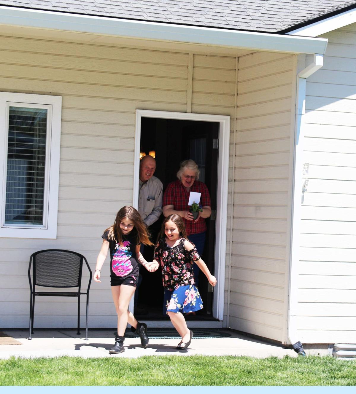 Pelican Elementary students share May Day spirit with neighbors