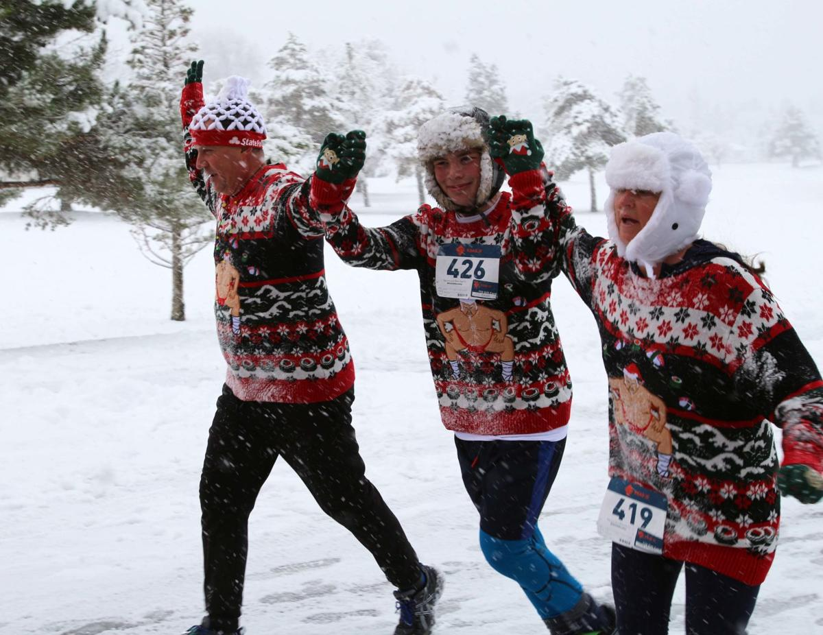 Three friends at ugly sweater run