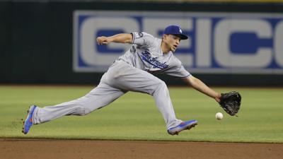 Peralta's hit gives D-Backs 3-2 win, stops Dodgers streak