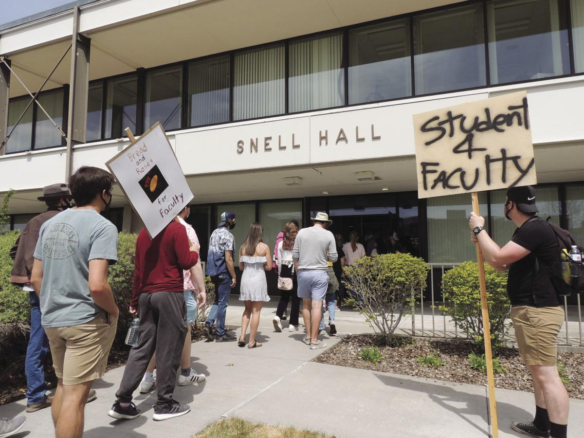 Students walk into Snell Hall for sit in