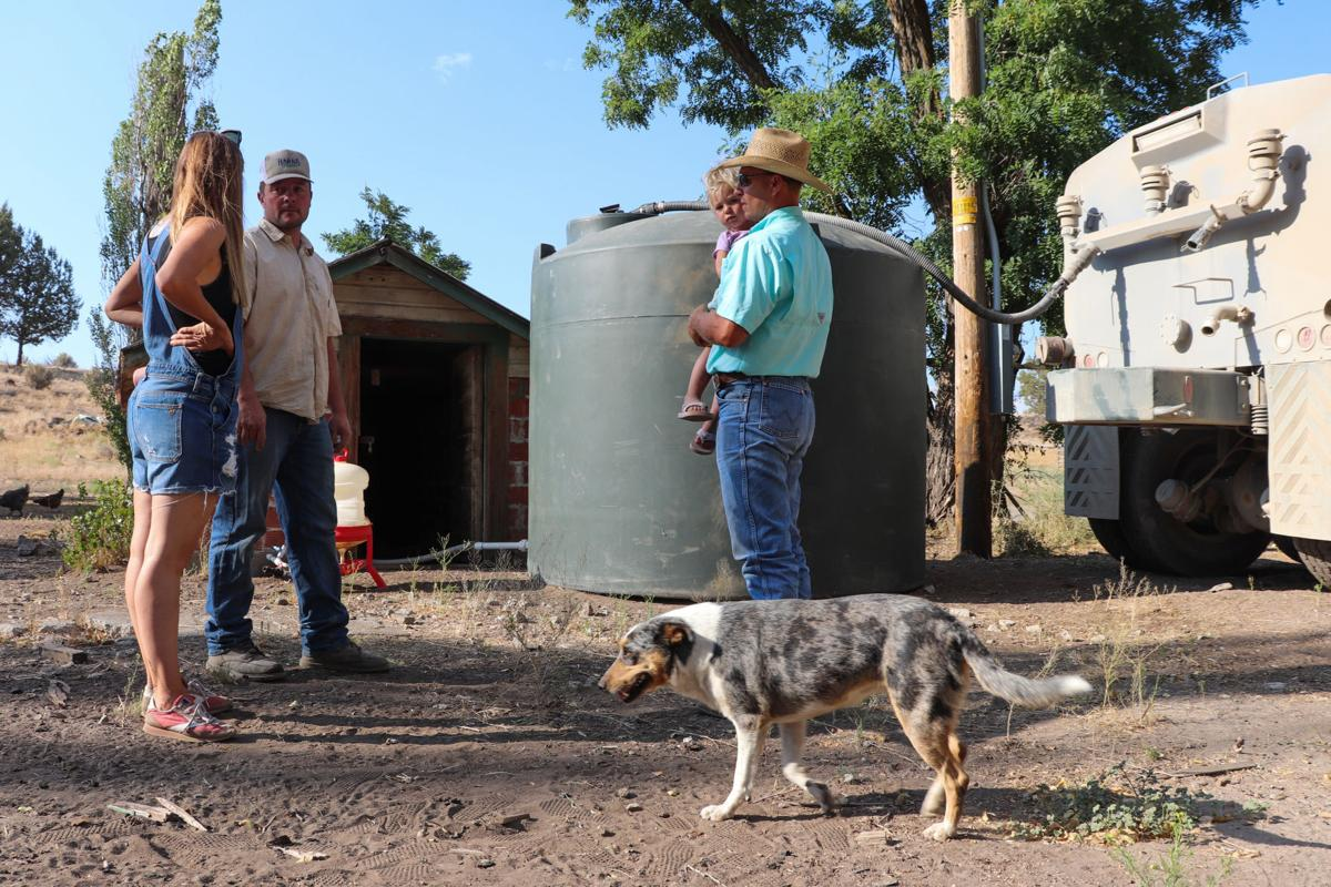 Steinberg family refills water tank