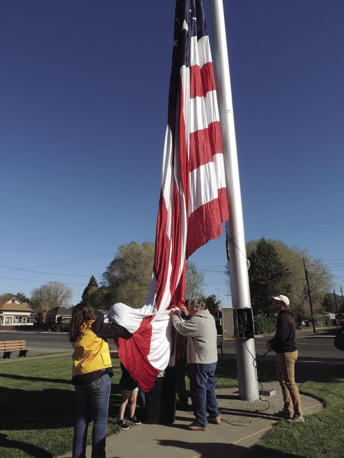 Raising the Memorial flag
