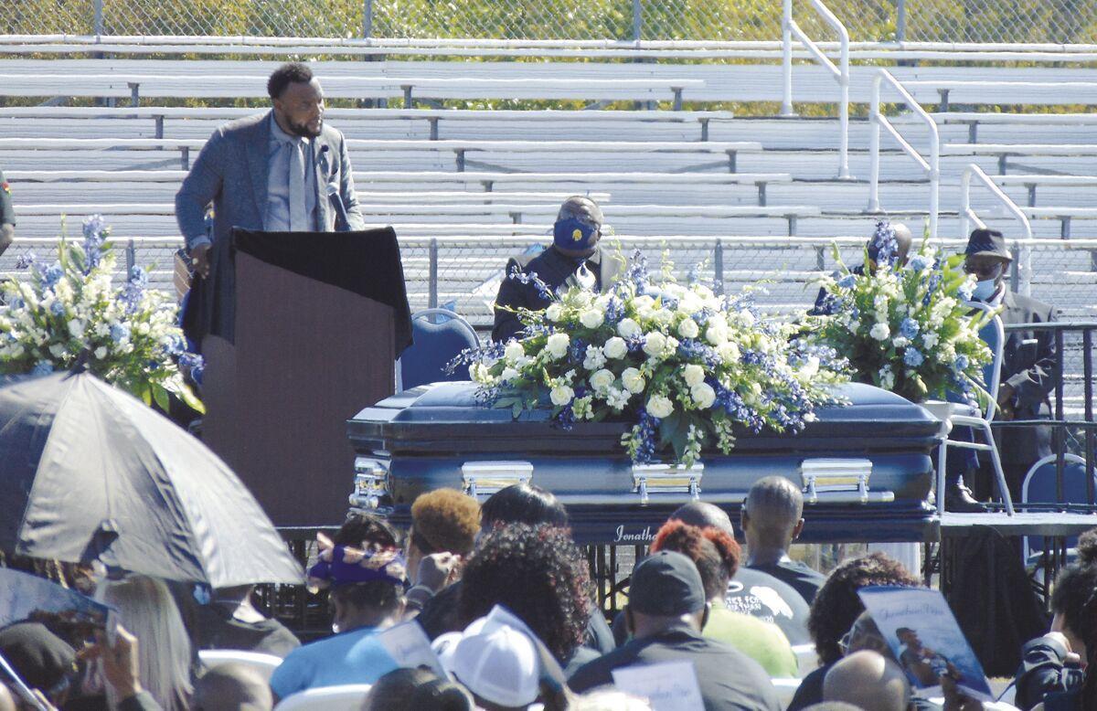 Lee Merritt speaks during Price memorial